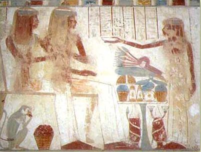 Apparently, a younger girl making an offering to two of Userhat's daughters in a banquet scene in his tomb