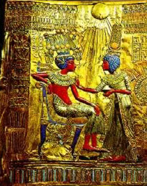 A depiction of King Tut and his wife from his Chair