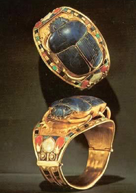 Gold Bangle with Openwork Scarab Encrusted with Lapis Lazuli