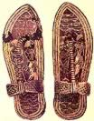 Tutankhamun's wood sandals with gold foil on stucco base