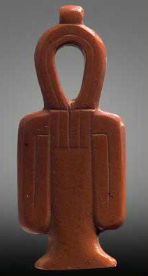 A tyet amulet dating to the early 18th Dynasty, discovered at Abydos