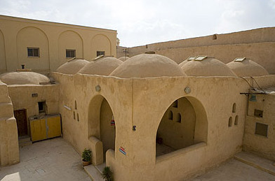 Monasteries at Wadi Naturn have similar architecture, with roofs often dominated by domes