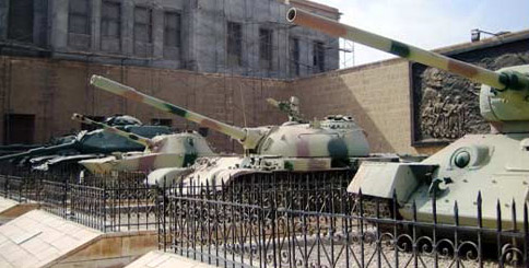 A column of different tanks on display at the exit to the museum
