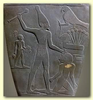 Narmer, smiting his enemy with a mace